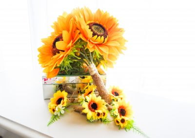 Gorgeous handmade sunflower bouquet and matching buttonholes by Marcia Shapland.