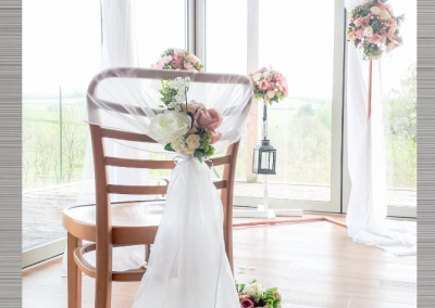Beautiful chairs and arch created by Marcia